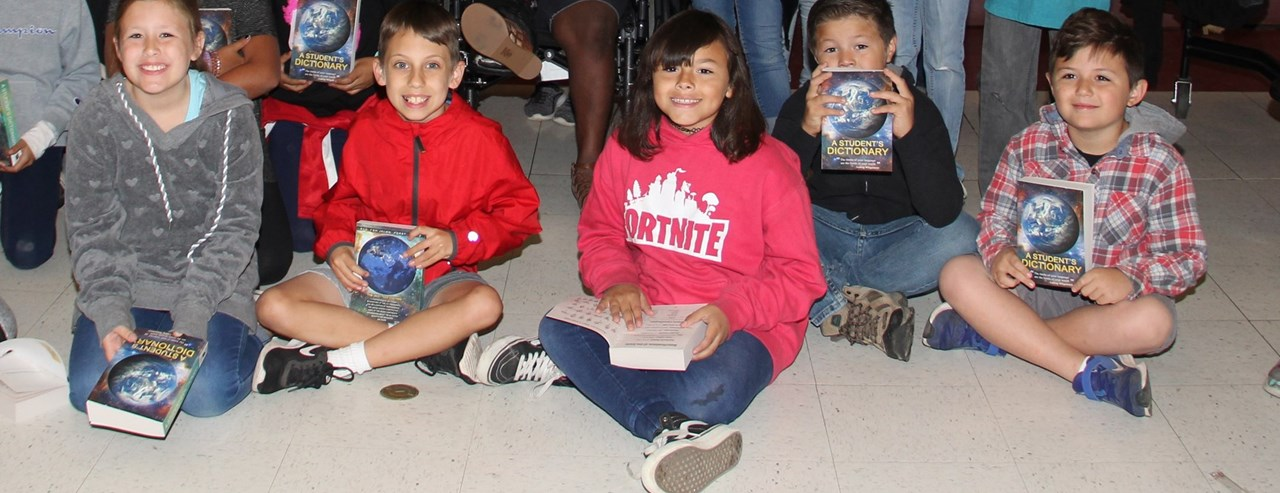 clovis rotary gives 3rd grade dictionaries